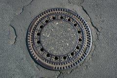 Street drain. A street drain outside on a street Royalty Free Stock Photos