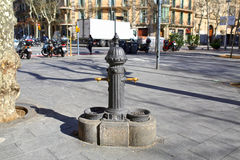 Street drinking column in Barcelona. Spain. Old street drinking founrain in the central district of Barcelona. Spain Stock Photos