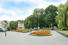Street in Drohobych town with nice park Royalty Free Stock Photo