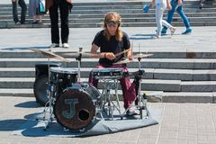 The Street Drummer. Kyiv, Ukraine - 07 08 2017: The street musician plays on drums Royalty Free Stock Photo