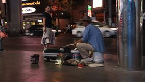 Street drummer. Young man in Bangkok used things from the trash as a drum kit for his street musical performance stock video