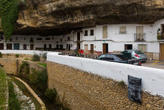 Street with dwellings built into rock overhangs above the Rio Royalty Free Stock Photography