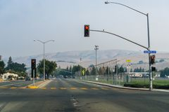 Street in East San Francisco bay area. Smoke and pollution in the air from nearby wildfires; hills barely visible in the background royalty free stock image