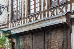 Street Eau de Robec in Rouen. Rouen, France - September 4, 2016: The street Eau de Robec in Rouen, with a quote of Flaubert on a house Stock Image
