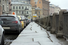 Street, embankment, parked cars, buildings, comes the cloudy day. Street, Saint Petersburg, pavement, stone tiles, stone fence, embankment, parked cars Stock Images
