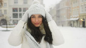 Street emotional portrait of young beautiful woman in city Model looking at camera. Lady wearing stylish classic winter stock video