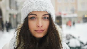 Street emotional portrait of young beautiful woman in city Model looking at camera. Lady wearing stylish classic winter stock video footage