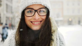 Street emotional portrait of young beautiful woman with glasses in city Model looking at camera. Lady wearing stylish stock footage
