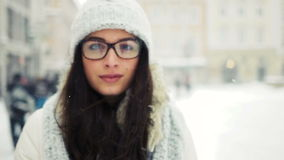 Street emotional portrait of young beautiful woman with glasses in city Model looking at camera. Lady wearing stylish stock video