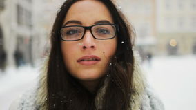 Street emotional portrait of young beautiful woman with glasses in city Model looking at camera. Lady wearing stylish stock video footage