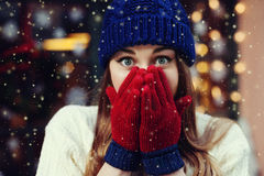 Street emotional portrait of young beautiful woman looking surprised and covering her mouth. Lady wearing stylish Stock Image