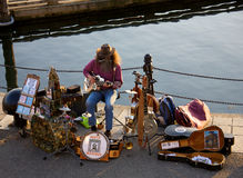 Street entertainer. A street entertainer playing music on the docks in Victoria Canada Royalty Free Stock Photos