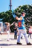 Street entertainer entertaining young children, sydney Australia Royalty Free Stock Image