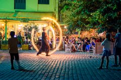 Street entertainer on a fire show in Chania, Crete, Greece. Street entertainer on a fire show in Chania, Crete, Greece on August 20, 2017 Stock Photo