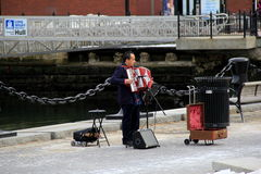 Street entertainer playing accordion,Boston,2014 Royalty Free Stock Images