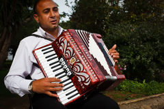Street entertainer playing the  accordion serenade Stock Image