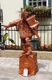 Street entertainer. QUEBEC CITY, CANADA - JULY, 20: Inca street performer in copper statue costume playing pan flute in Old Quebec city, Canada on July 20, 2014 Stock Photos