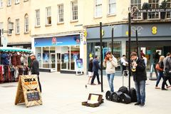 Street entertainer scene. BATH ENGLAND -OCT 18 :  Atmosphere of street entertainer during show performance on the city street represent the british tourism Royalty Free Stock Images