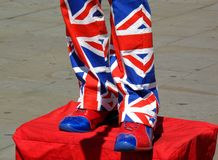 Street entertainer wearing Union Jack suit. Street entertainer wearing a suit made of the Union Jack flag of the United Kingdom royalty free stock photo
