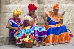 Street entertainers in Havana, Cuba. Cuban Women dressed in national costumes working on the streets of Havana stock photography
