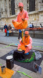 Street Entertainers in Milan Italy. Street entertainers in the Piazza del Duomo performing an optical illusion while meditating. Milan, Italy royalty free stock images