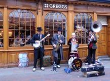 Street Entertainers. Street Performing playing at Bury St. Edmund UK on a crisp November Sunday Royalty Free Stock Image
