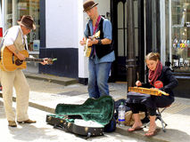 Street entertainers, St.Ives, Cornwall. A Jazz trio busking on the streets of St. Ives, Cornwall, England, UK stock photos