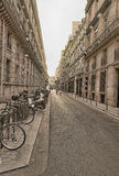 Street of the European city. The street in Paris in cloudy day Stock Images