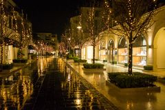 Street in the evening in lanterns after rain.  Royalty Free Stock Photo