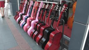 Street exhibition of guitars, trade showcase of musical instruments. Street exhibition of guitars, trade showcase of musical instruments stock footage