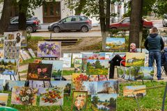 Street exhibition of paintings of Russian artists. Russia, Suzdal, September 2017. stock photography