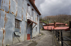 Street and facade of a house in Milia village, near Metsovo, Greece Royalty Free Stock Image