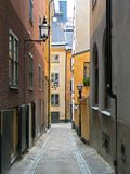 Street from fairy tail. Medieval narrow street; Stockholm, Sweden Royalty Free Stock Image