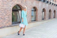 Street Fashion. Beautiful Blonde Woman In Turquoise Dress Stock Photo