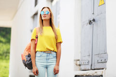 Street fashion concept - bright hipster girl in sunglasses. Outdoors posing in the city stock photos