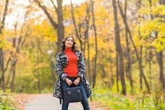 Street fashion concept - closeup portrait of a pretty girl. Beautiful autumn woman. Street fashion concept - closeup portrait of a pretty girl. Wearing hat and Stock Photos