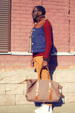 Street fashion concept - handsome stylish african man with bag Stock Images
