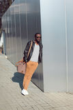 Street fashion concept - handsome stylish african man standing Royalty Free Stock Photo