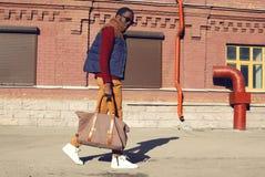 Street fashion concept - handsome stylish african man walks Stock Photo