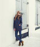 Street fashion concept - pretty hipster girl in urban style Royalty Free Stock Image
