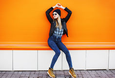 Street fashion concept - stylish cool girl in rock black style