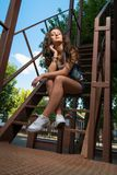 Street fashion of contemporary youth girl.summer young woman wit Stock Images