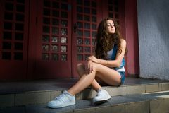 Street fashion of contemporary youth girl.sexy brunette girl wit