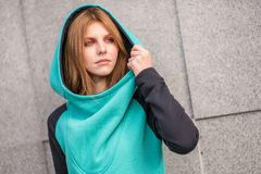 Street fashion. Cute red head model on the street. Royalty Free Stock Image