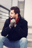 Street fashion, handsome brunet man stock images
