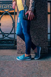 Street fashion look with jeans and black leather handbag Royalty Free Stock Photos