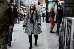 Street fashion in New York, Manhattan. Fashionable people walking on a sidewalk in NY, Manhattan. New York is a very vibrant place where people dress in many stock photos