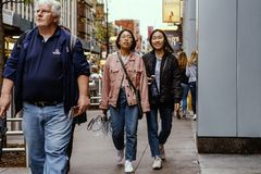 Street fashion in New York, Manhattan. Fashionable people walking on a sidewalk in NY, Manhattan. New York is a very vibrant place where people dress in many stock photo
