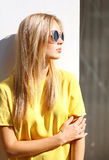 Street fashion photo, stylish pretty hipster girl in sunglasses Royalty Free Stock Image