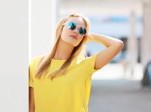 Street fashion photo, stylish pretty hipster girl in sunglasses Stock Photography